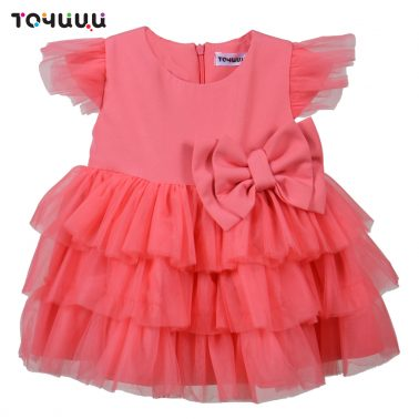 Елегантна рокля с волани от тюл и панделка в розово