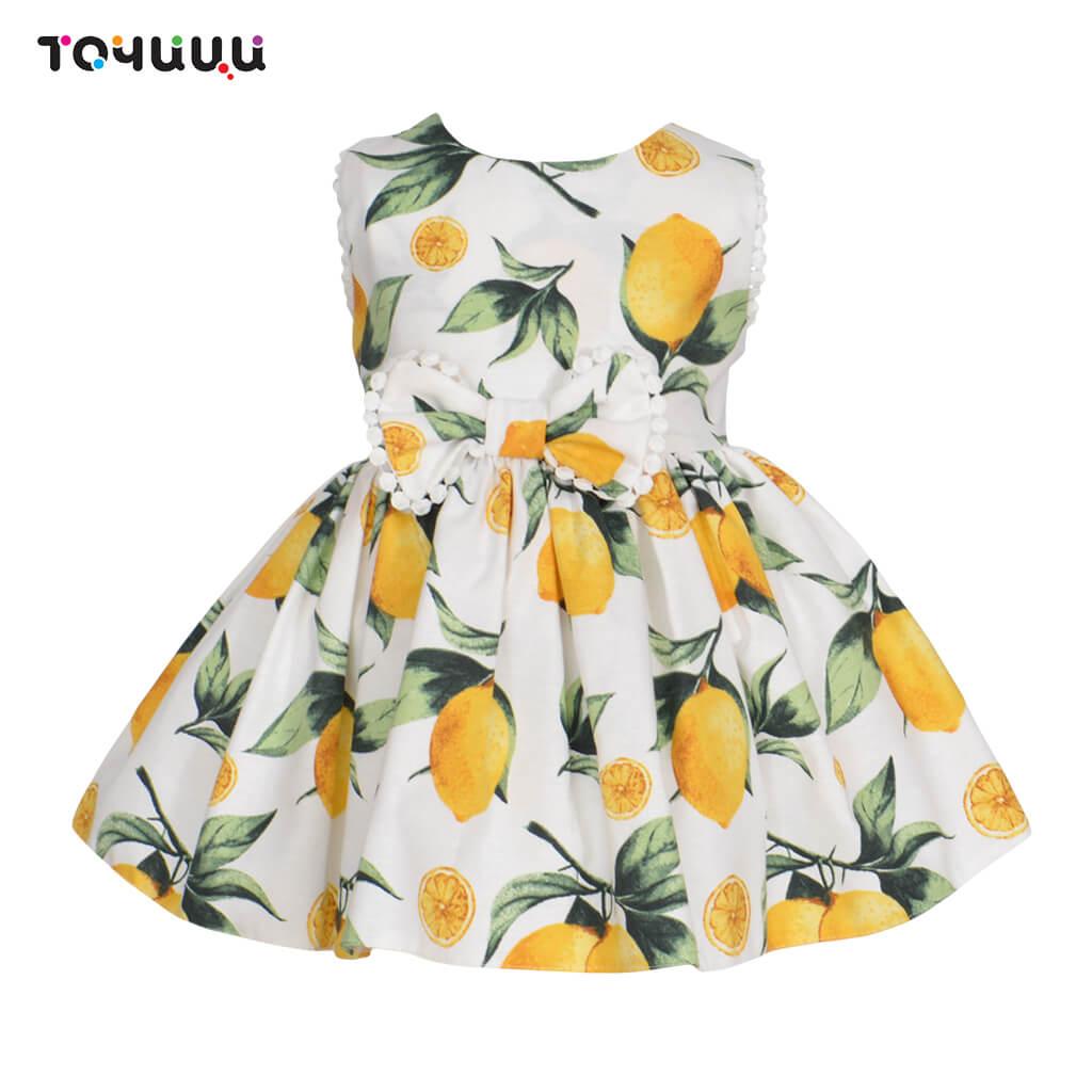 Детска рокля с панделка и принт лимони в бяло